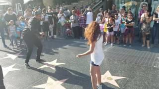 9year old girl stops and dances w/ street performer
